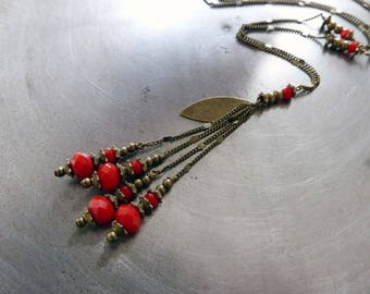 """Necklace """"etourdies"""" beads, red faceted glass."""