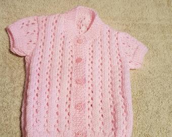 Pink short sleeved babies cardigan. Size 0-9 months
