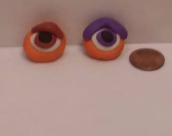Two Disposable Erasers of Close-Ups of Eyes of Phabrisaurs