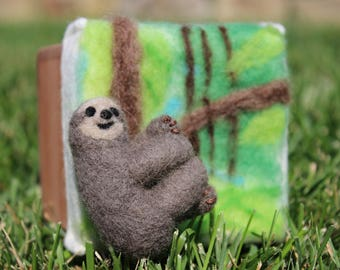 Needle felted three-toed sloth in handmade cedar box with tropical forest tree scene