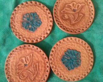 Set of 4 tooled leather coasters.