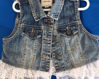 Childs jean vest with lace.