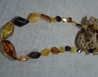 Amber necklace made of beads in the form of crystals