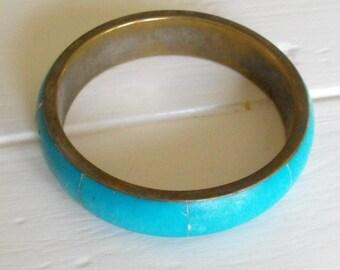 Blue stone bangle bracelet.