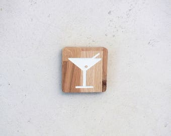 Wooden door sign with engraved cocktail logo for the bar