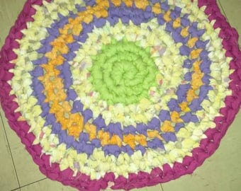 Whimsical brightly colored rag rug