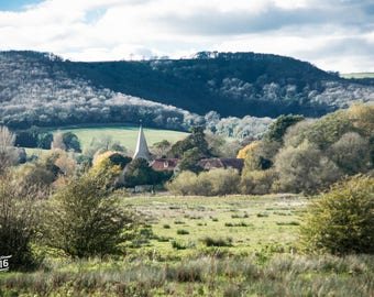 A church and houses at the foot of a hill Photo / Poster / Canvas