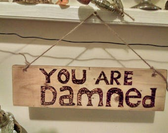 Wall hanging you are damned sign
