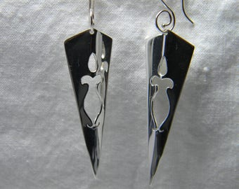 Striking cutout design,handmade sterling silver earrings.