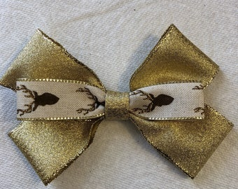 Gold and deer bow