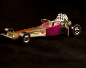 Photograph of a vintage toy hot rod.