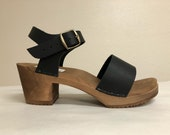 Wide strap sandal on Medium heel in Black oiled with Buckled ankle strap