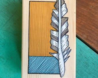 Feather ink illustration on mini wood block
