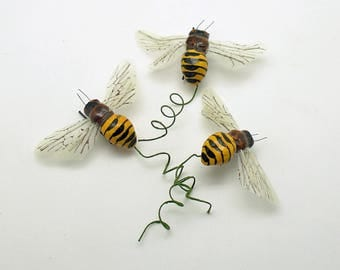 Bumble Bee Picks Bees on Wire Stems