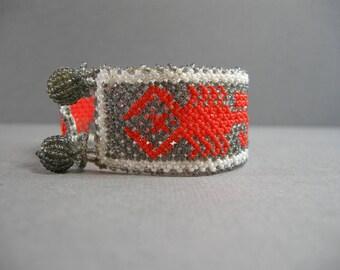 vintage beaded bracelet, small bead bracelet, scorpion design, bright orange scorpion on gray background, scorpio, for small wrist