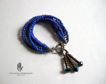 Multi Strand Blue Beaded Dangles Bracelet