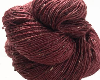 "Donegal tweed yarn, hand dyed, fingering weight, 438 yds, 2 ply, cranberry, ""Grainne"",  BFL and nylon blend"