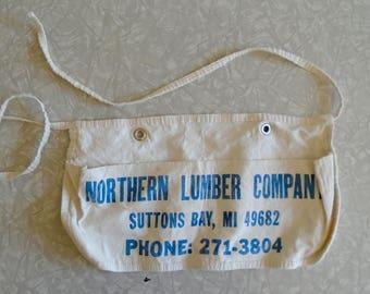 vintage nail apron, northern lumber company, suttons bay, michigan, vintage northern michigan souvenir, leelanau county, small canvas apron