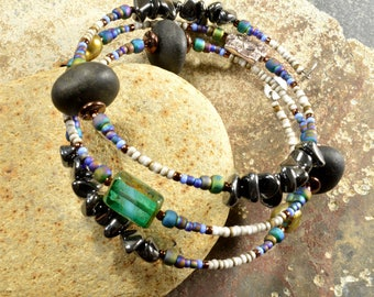Drama queen a hematite and genuine Maine sea / beach stone adjustable wrap bracelet  with deep blue colors