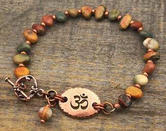 Om bracelet, multicolor semiprecious stone red creek jasper beads, warm earthtones, copper, 8 inches long