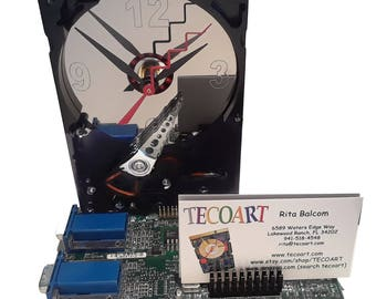 Business Card Holder Hard Drive Clock from Recycled Hard Drive and Video Circuit Board.