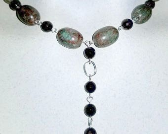 Natural Green and Red Garnets with Faceted Round Garnets
