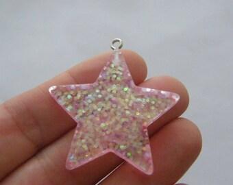 2 Star pink resin pendants S175