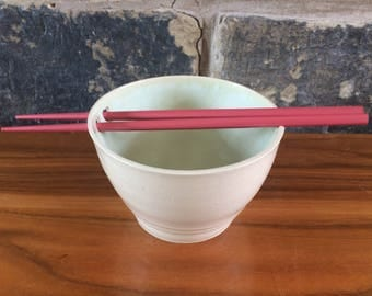 Chopstick sushi rice bowl in creamy earthenware with pale winter green glaze