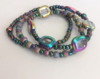 Three Stretch Bracelets of Iridescent Glass Beads