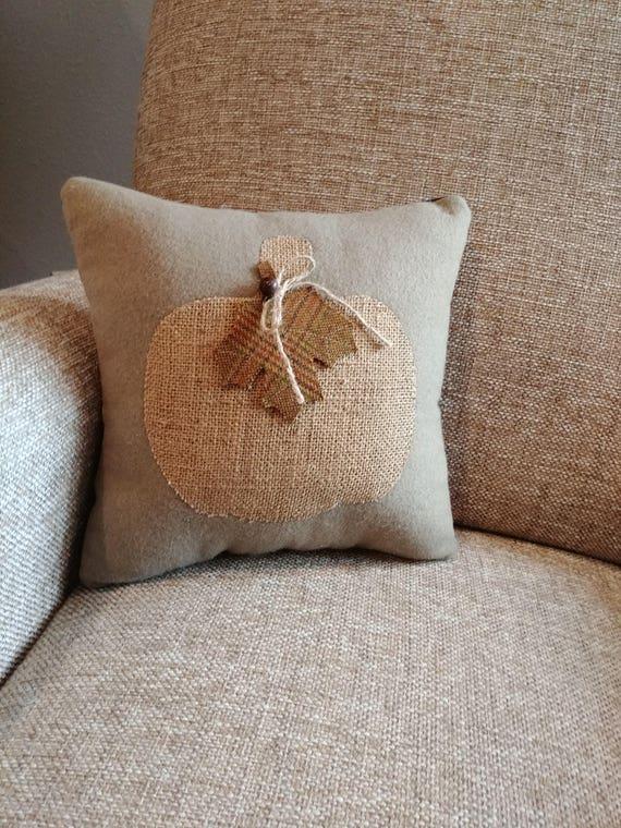 decorative pillow with burlap pumpkin