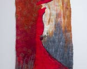 women in red handfelted wall hanging