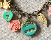 Mom Charms Bracelet with Kids initials, Hearts, Flowers, Nest, Butterflies and Angel Wings in Green and Peach
