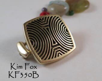 Chartres Patterned Rounded Rectangular Loop Clasp that is exchangeable designed by Kim Fox in Bronze