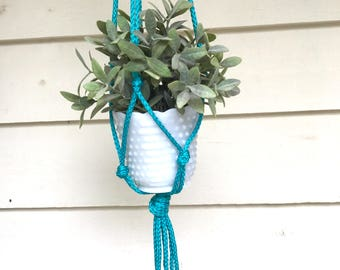 The seventies are back!  Macrame plant holder.
