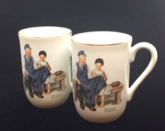 """Set of two Norman Rockwell Museum """"The Lighthouse Keeper's Daughter"""" Mugs"""
