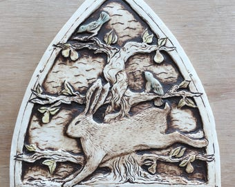 Handmade ceramic rabbit tile with birds and a pear tree
