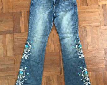 Vintage 90s boot cut jeans with embroirdy beaded design.
