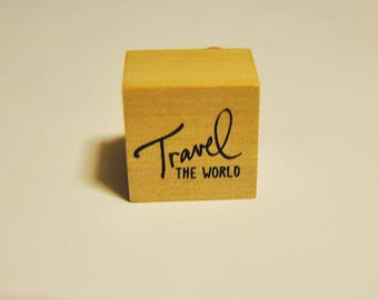 Travel the World rubber stamp. earth. world map. new. miniature. small.