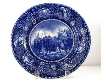 Flow Blue Landing of the Pilgrims porcelain plate from AS Burbank