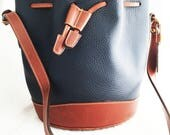 Coach- Bucket bag navy pebbled leather with british tan trim over the shoulder