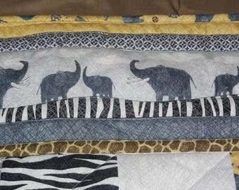 Baby Quilt.  Elephants and Zebras on a Patchwork Baby Quilt.  Gender Neutral Colors, Grey, Black, White and Maize.  Eye Catching Prints.