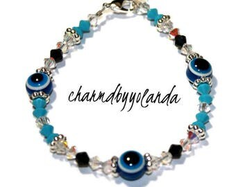 Crystallized Crystal Evil Eye Bracelet with Silver Spacers Features Aqua Clear and Black Crystals