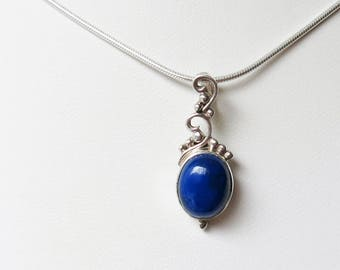 Sterling silver and lapis lazuli oval cabochon pendant