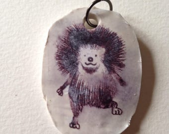 hedgehog pendant.