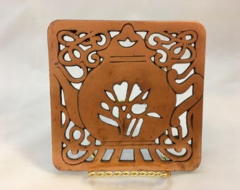 Brass teapot trivet or wall hanging.