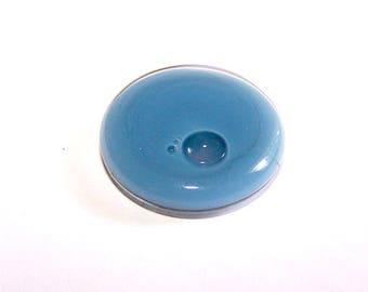 A globe round 26 mm opaque light grey liquid filled glass