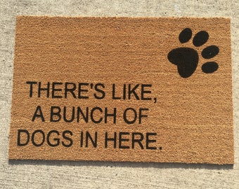 Theres like, a bunch of dogs in here painted custom doormat