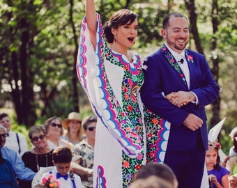 The Beautiful Hand Embroidered Kimono/Tunic Style Mexican Dress with a twist! Our famous beauty just got sexier!!And look at the Groom!!Wow
