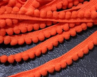 2 meters of 6mm Orange clementine tassel trim