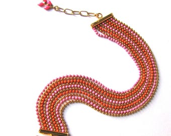 Bracelet 10 rows chains in Golden, orange and pink beads